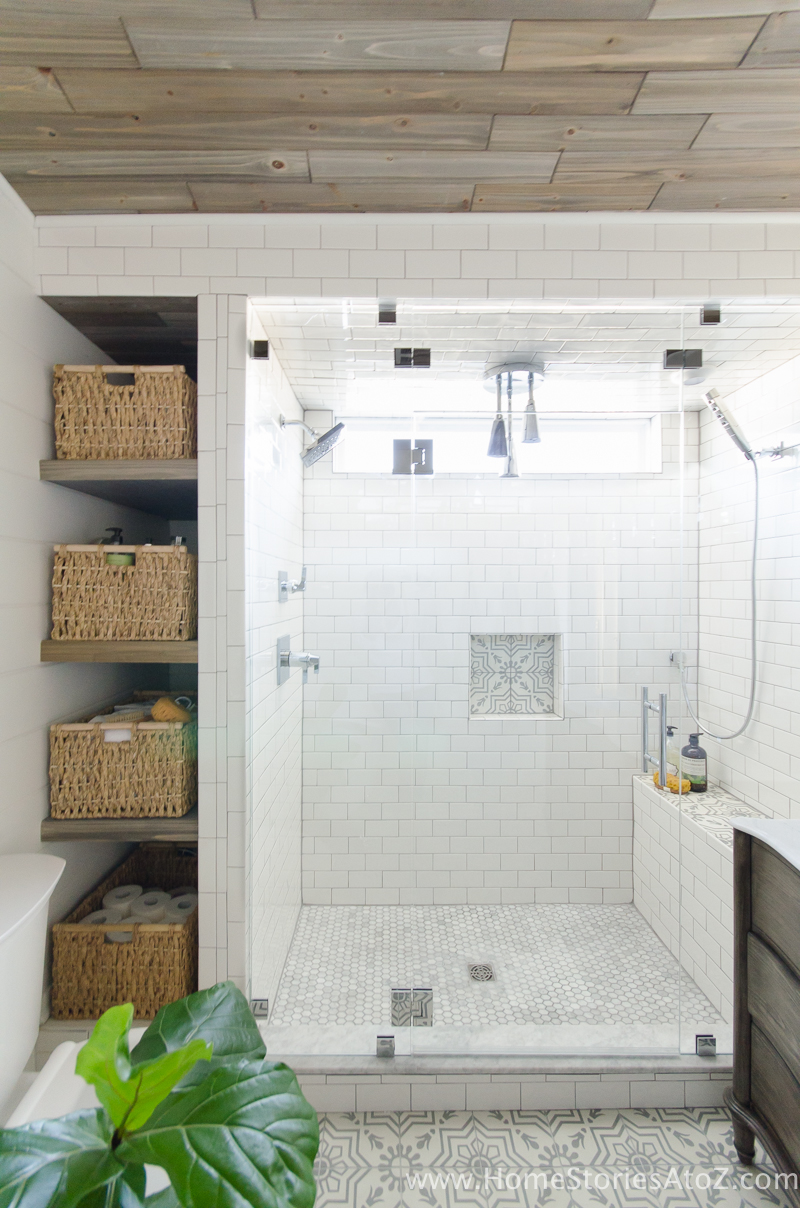 Beautiful bathroom remodel with steam shower and deep open shelving next to the shower.
