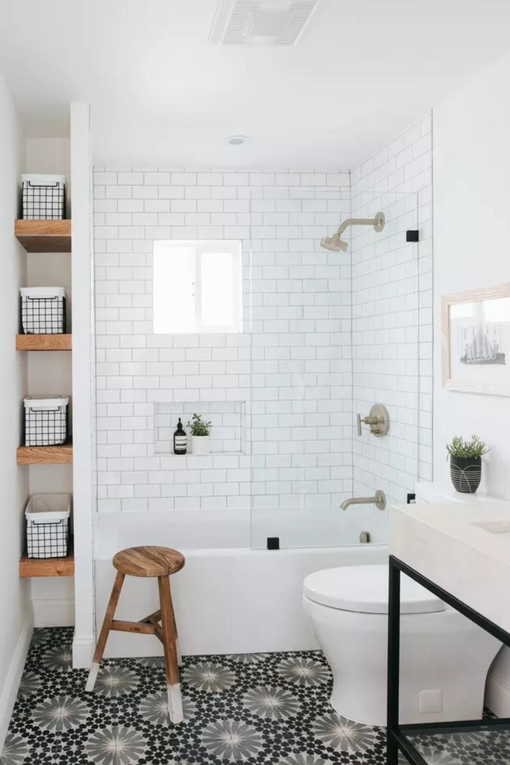 Make the bathtub a few inches shorter to make room for a row of open shelves for storage.
