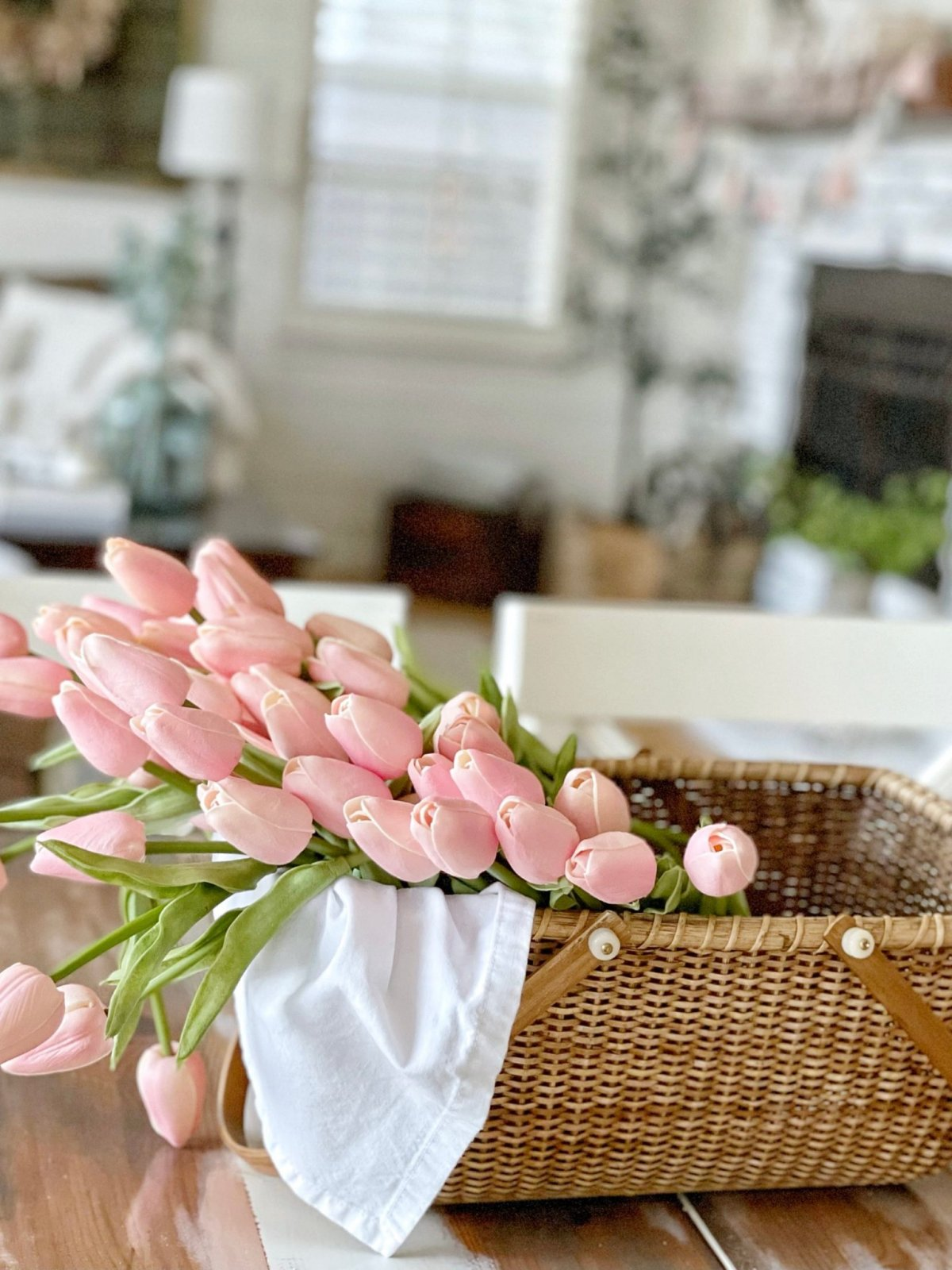 Simple spring decor pink tulips in a basket.