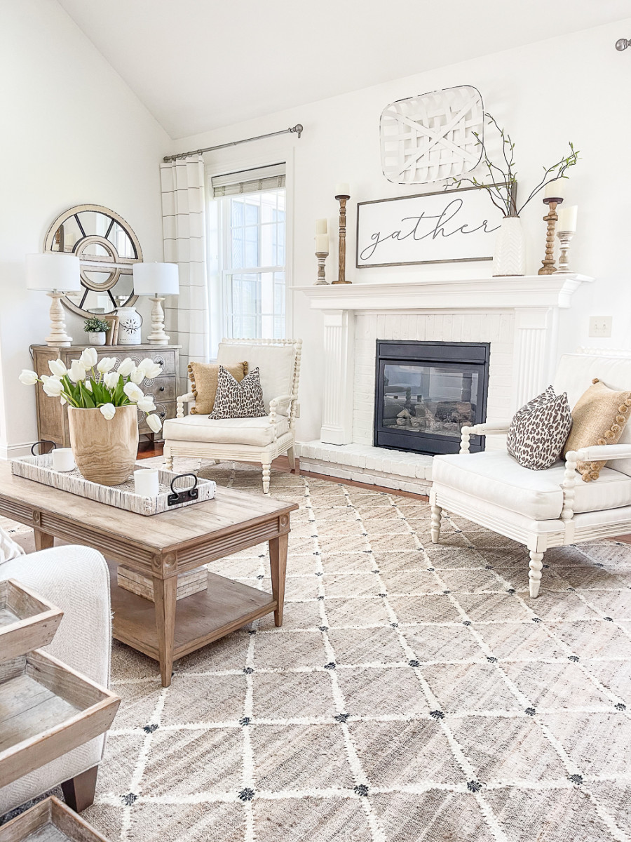 traditional wood and white living room with gather sign on mantel.