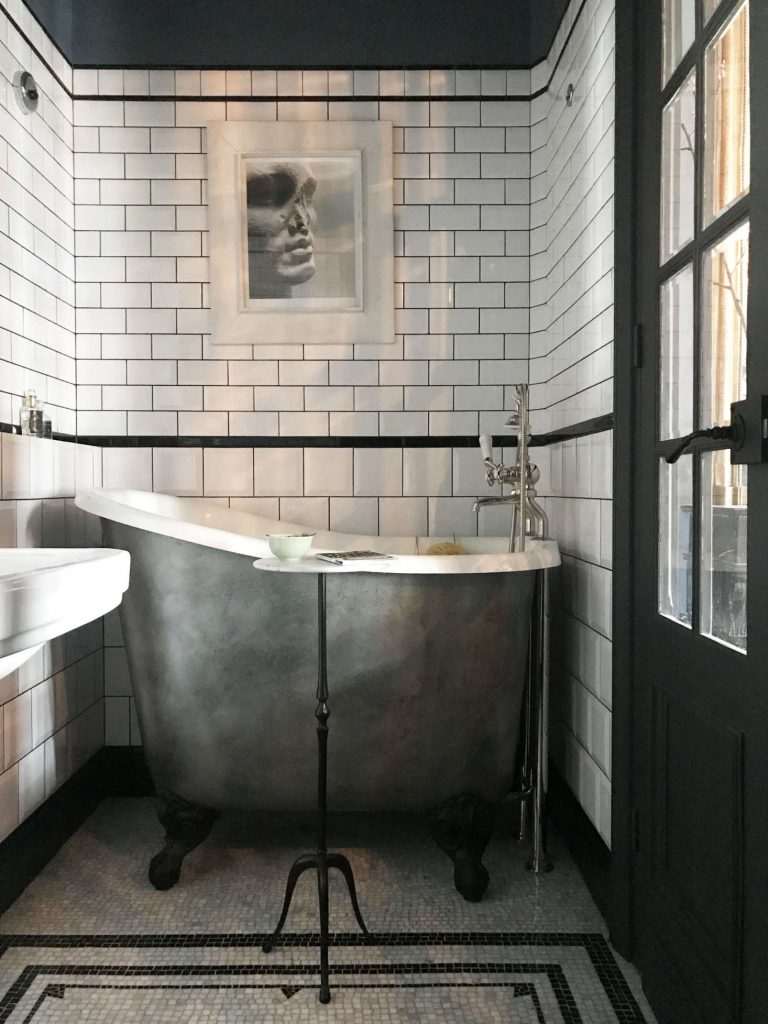 A very small and deep clawfoot tub in an english bathroom remodel.
