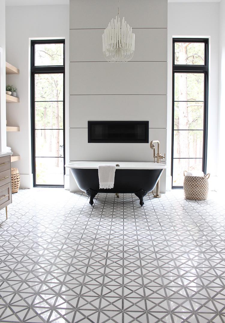 Black clawfoot tub with modern tile.