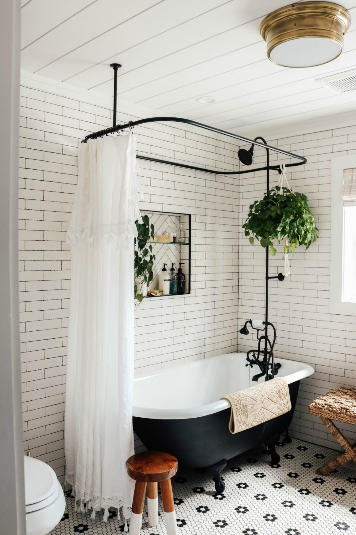 Master bathroom remodel at Nesting with Grace using a black clawfoot tub and classix hex tile.