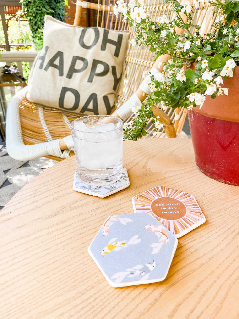 Summer Decoupage Concrete Coasters. Personalize concrete coasters with pretty paper for a DIY that's super easy and so fun to make with kids!