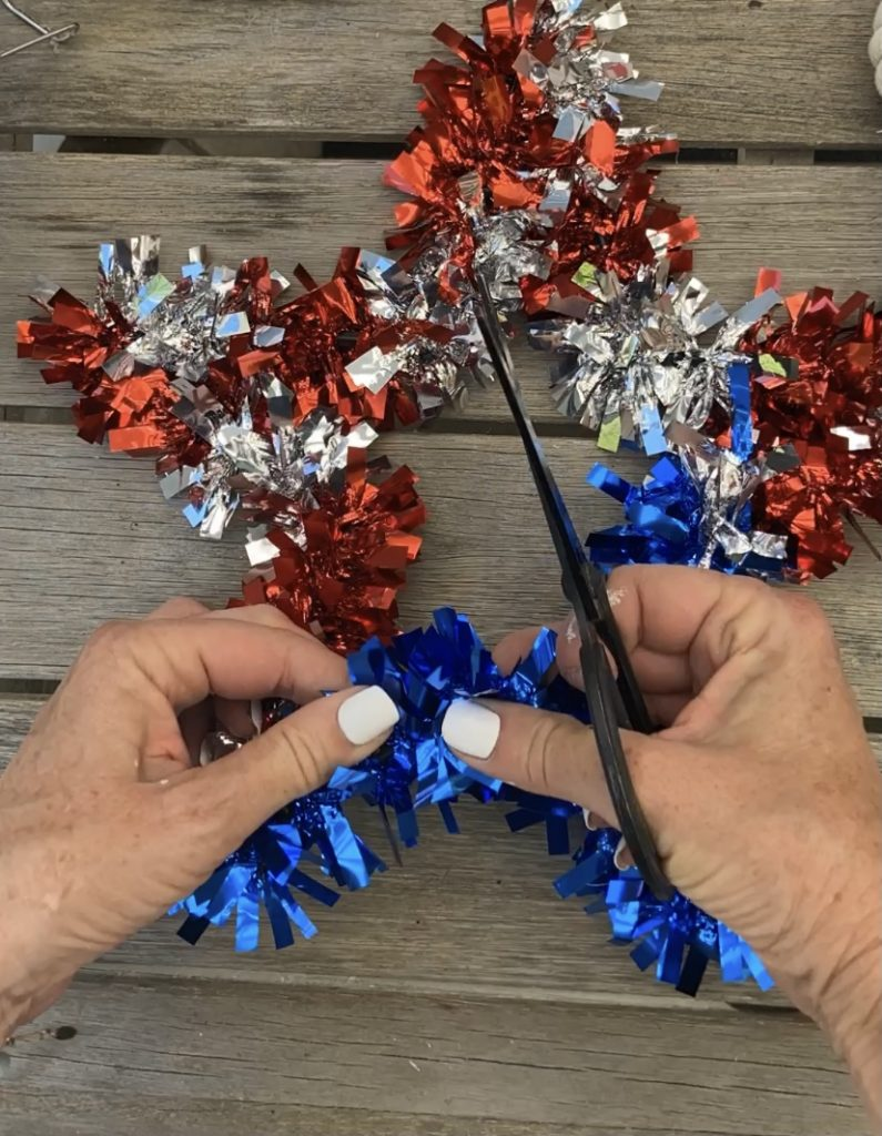 Dollar Store Neutral Patriotic Wreath. Grab a glittery star, some rope from the Dollar Store and create a neutral star wreath for summer!