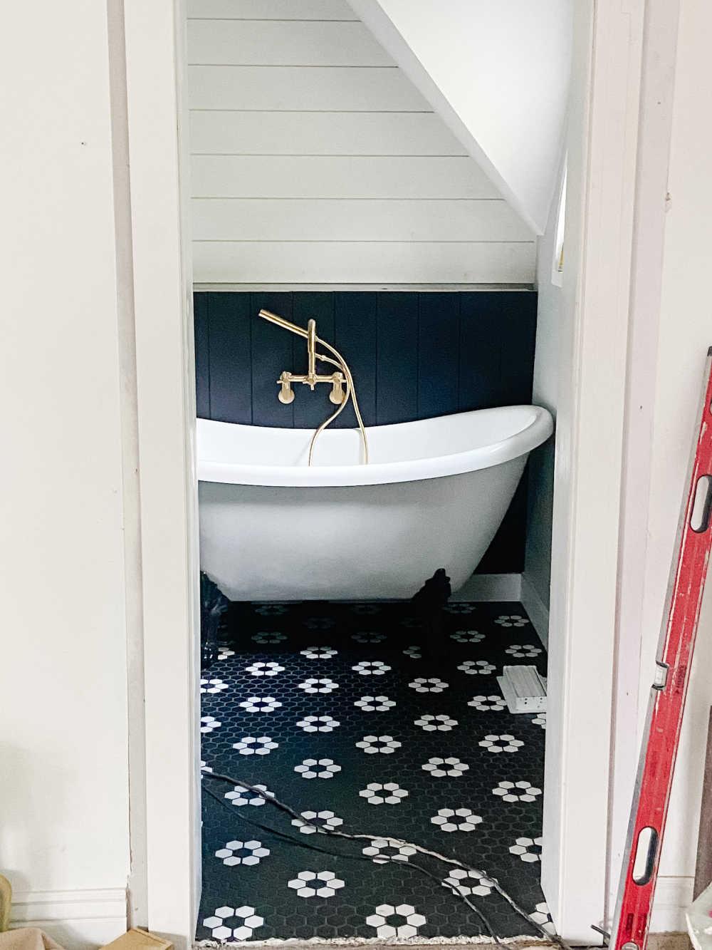 Black and white modern vintage bathroom remodel.