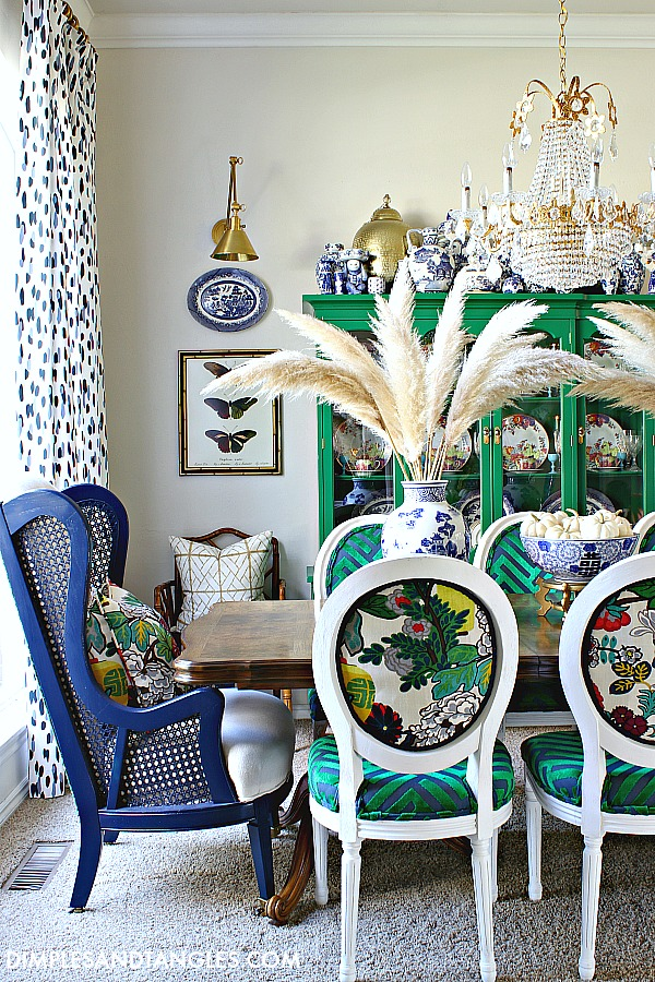 Colorful Fall Decorating Ideas at Dimples and Tangles. .Colorful DIning Room table and chairs with pampas grasses in blue and white ginger jars.