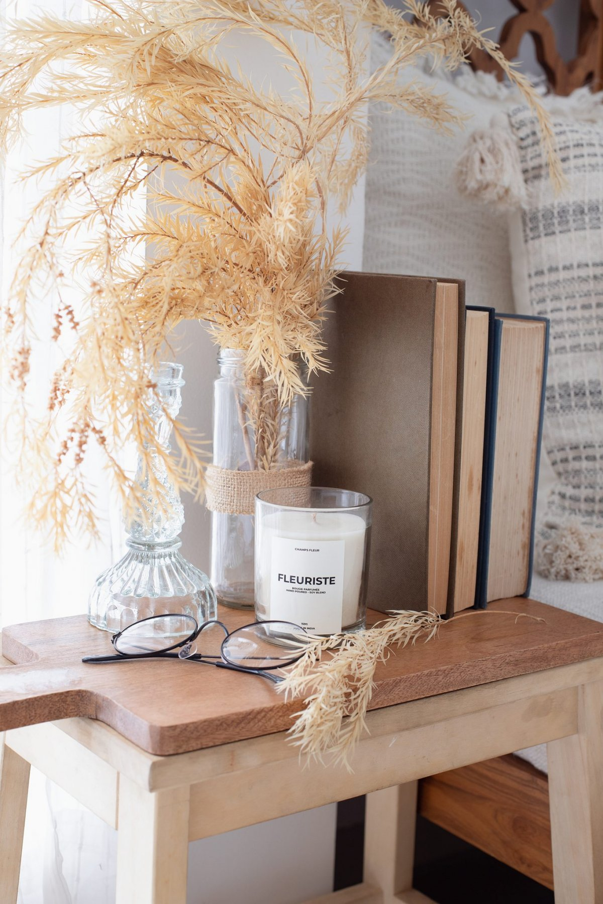 Wheat Arrangement and candles at Sincere Storyteller