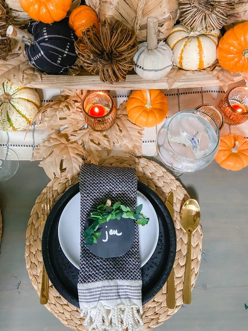 DIY Wood Chalkboard Pumpkin Place Markers. Get ready for fall entertaining by making these easy pumpkin-shaped wood chalkboard place markers! It's a 10-minute project that can be used all autumn long!