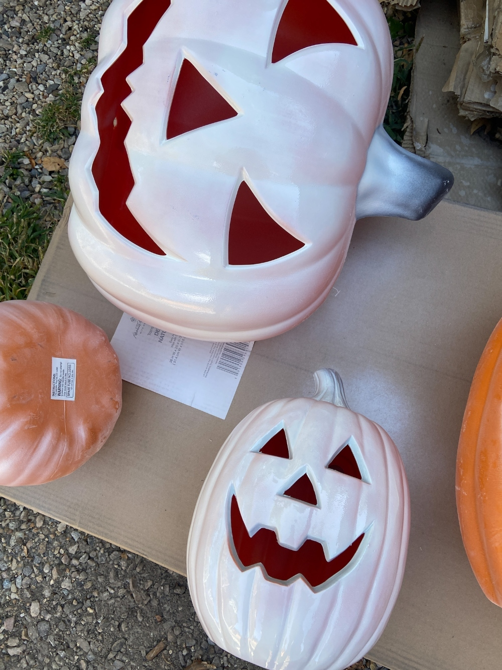 The Great Pumpkin Halloween Porch! Spray paint inexpensive jack-o-lanterns, pumpkin pails and make a jack-o-lantern topiary for a festive pumpkin porch!