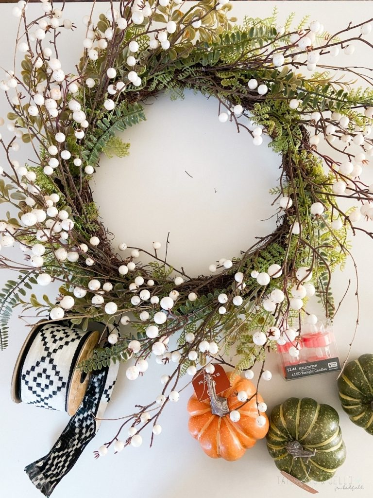 Light Up Pumpkin Farmhouse Wreath. Carve the middle of foam pumpkins, add light-up votives and add them to a wreath for a pretty wreath that also lights up at night!